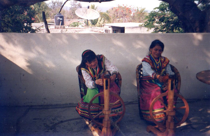 Cora women learn to use the wheel